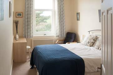 The master bedroom is comfortably furnished with a double bed (Bedroom 1).