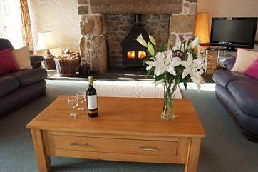 Warm your toes and the wine in front of the trusty wood-burner - perfect holiday occupations!