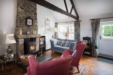 The sitting room with cosy wood burner.