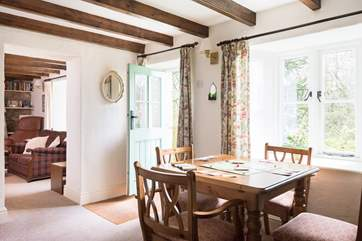 The front door of the cottage opens onto the snug, a quiet room ideal if you have to work whilst on holiday.