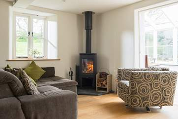 A comfy spot to sit and relax with a good book - beside the wood-burner in the sitting-area.
