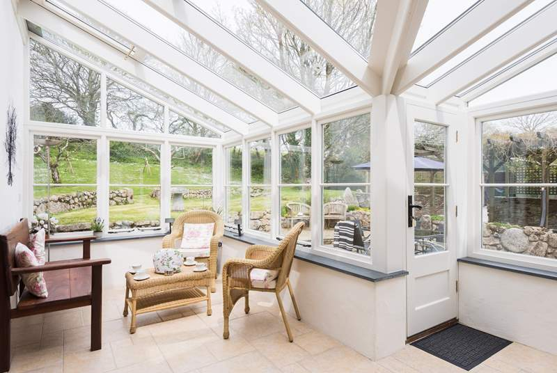 The airy and light filled conservatory, a great spot to relax with family and friends whatever the weather.