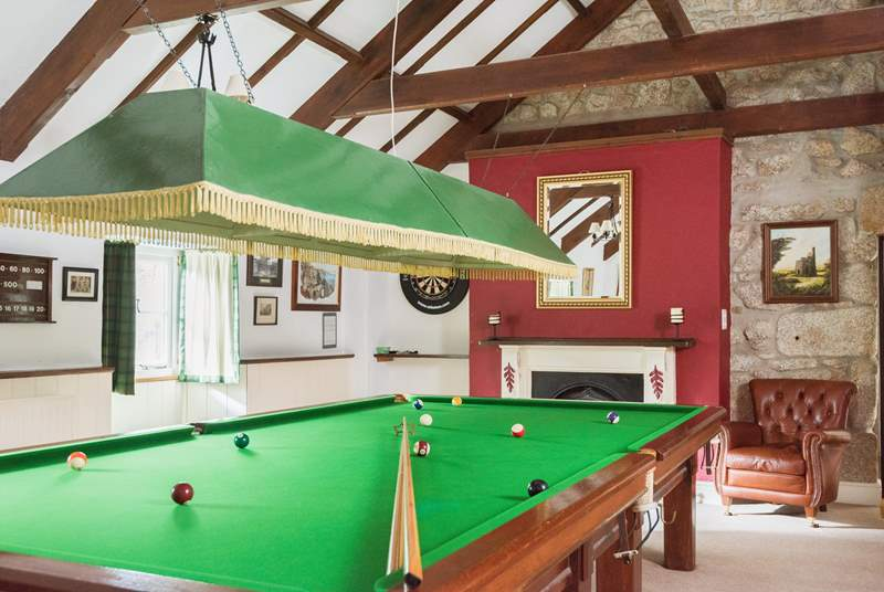 The fabulous games-room has a full-sized snooker table.