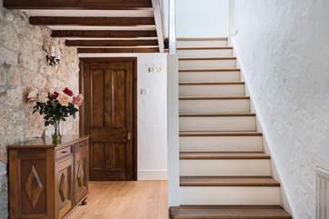 The inner hall with staircase rising to the bedrooms and family bathroom.