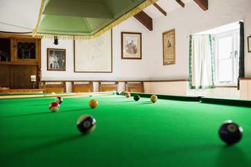 The games-room with full-size snooker table, dart board and a shelf full of games behind the bar!
