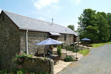 The cottages each have a sunny front patio.