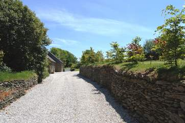 The pretty driveway leading to the cottages.