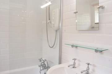 The modern white bathroom is fresh and light.