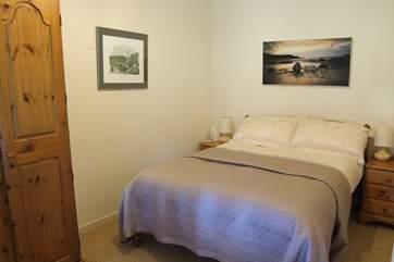 The tastefully furnished bedroom.