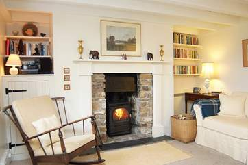 The spacious sitting/dining-room has a toasty wood-burning stove - perfect for cooler evenings.