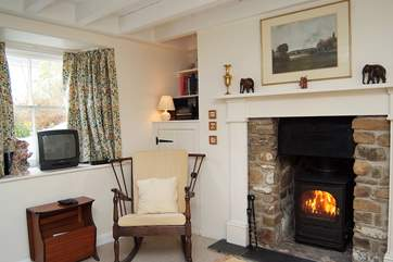 The warming wood-burner adds to the charm of this lovely cottage.