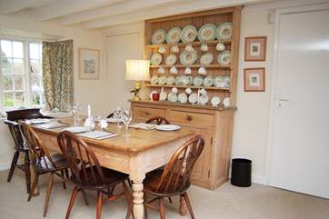 The old pine dresser blends perfectly with the dining furniture.