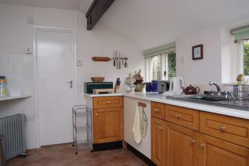 One end of the spacious kitchen, with the door into the bathroom.