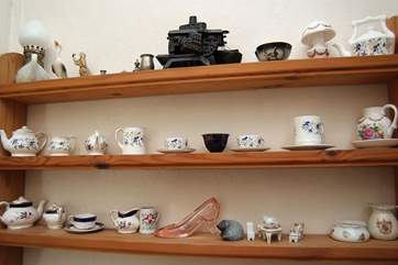 A collection of miniature china and glass.