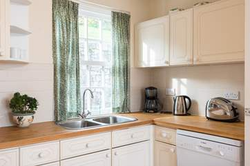 The kitchen area is light and bright and fully equipped.