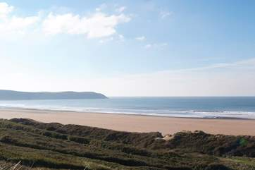 The owners even provide you with a  car parking permit for the Putsborough Beach car park. Miles of golden sand and surfing at the Woolacombe end to the right.