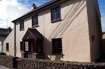 The cottage fronts onto the little village road, parking is to the left-hand side and from there you can go straight through to the patio.