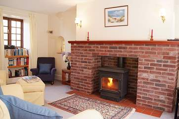 This lovely cosy sitting-room has a wood-burner making this a great place to stay out of season as well as in the summer.