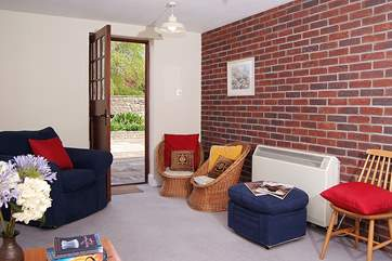The snug or playroom has a door right out onto the fully enclosed and private patio.