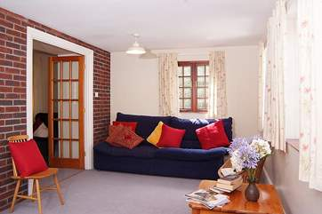 The second sitting-room is spacious and ideal for children to play in.